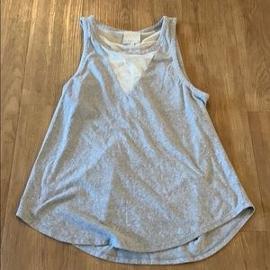 Tank top with a mesh and open back .